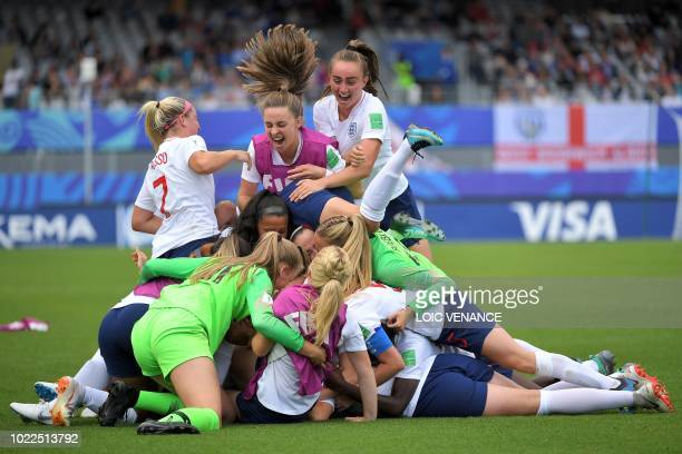England's players celebrate after winning the Women's U20 World Cup play-off for third place football match between France and England on August 24...