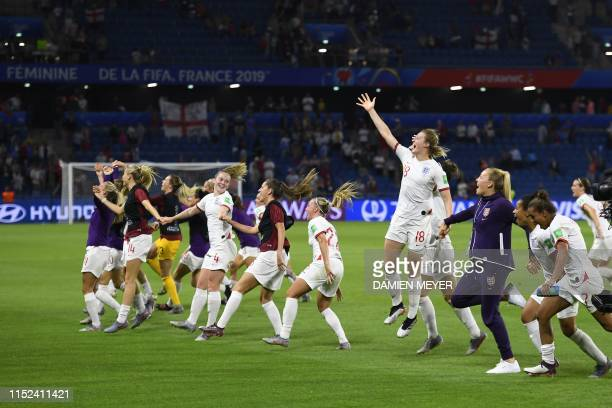 England's players celebrate at the end of the France 2019 Women's World Cup quarterfinal football match between Norway and England on June 27 at the...