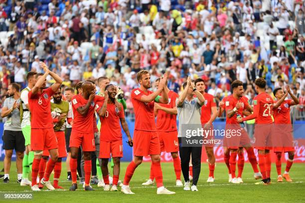 TOPSHOT England's players celebrate at the end of the Russia 2018 World Cup quarterfinal football match between Sweden and England at the Samara...