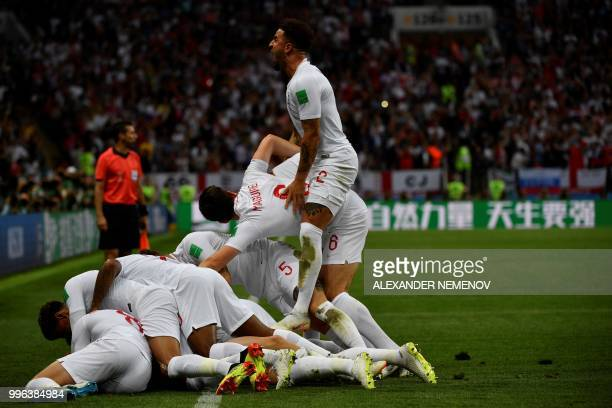 England's players celebrate scoring the opening goal during the Russia 2018 World Cup semi-final football match between Croatia and England at the...