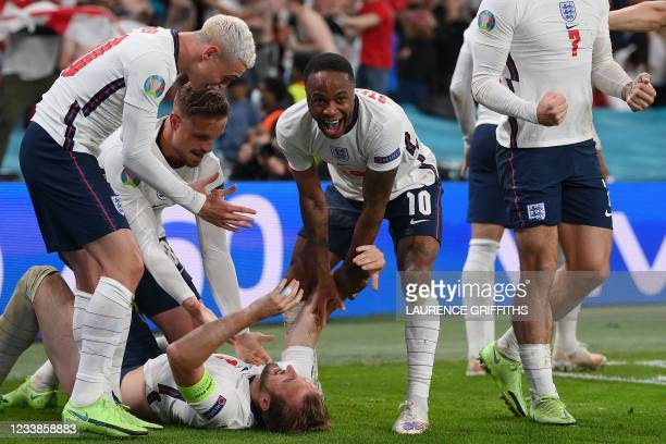 England's players celebrate the second goal during the UEFA EURO 2020 semi-final football match between England and Denmark at Wembley Stadium in...