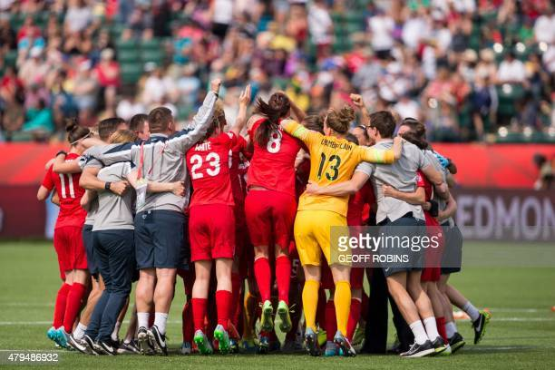 England's players celebrate their 1-0 win over Germany in the bronze medal match at the 2015 FIFA Women's World Cup in Edmonton, Alberta on July 4,...