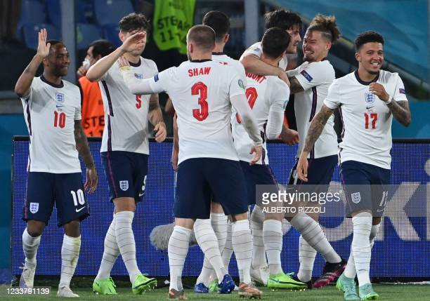 England's players celebrate their second goal during the UEFA EURO 2020 quarter-final football match between Ukraine and England at the Olympic...