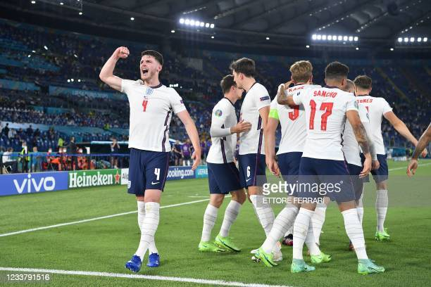 England's players celebrate their third goal during the UEFA EURO 2020 quarter-final football match between Ukraine and England at the Olympic...