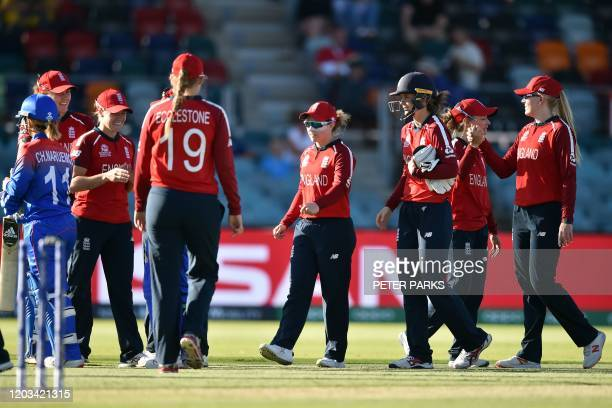 England's players celebrate their victory against Thailand during the Twenty20 women's World Cup cricket match between England and Thailand in...