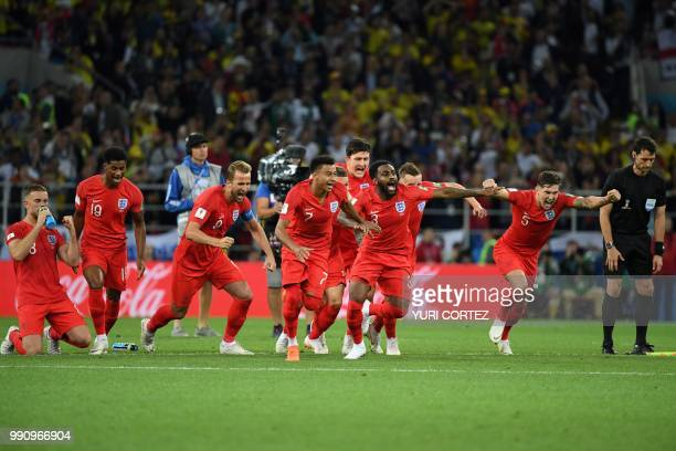 TOPSHOT England's players celebrate winning the penalty shootout at the end of the Russia 2018 World Cup round of 16 football match between Colombia...