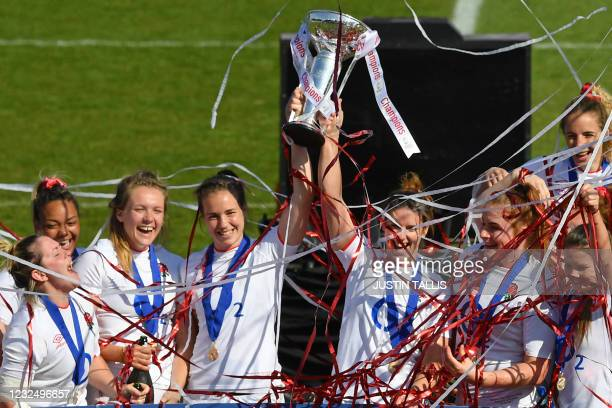 England's players celebrate with the trophy after the final whistle in the Six Nations international women's rugby union final match between England...