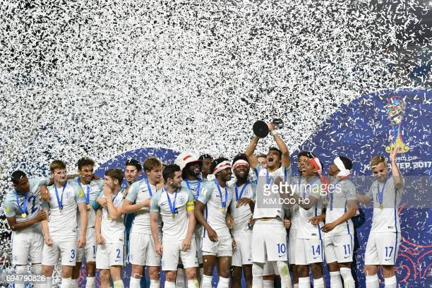 TOPSHOT England's players celebrate with the trophy during the awards ceremony after winning the U20 World Cup final football match between England...