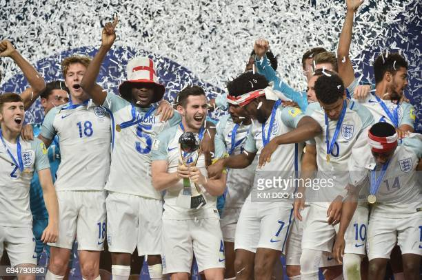 England's players celebrate with the trophy during the awards ceremony after winning the U20 World Cup final football match between England and...