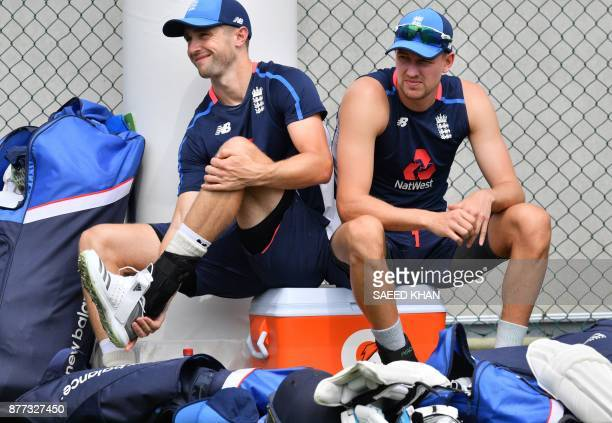 England's players Chris Woakes and Jake Ball get ready for a net session in Brisbane on November 22 ahead of the first Test of the Ashes Series / AFP...