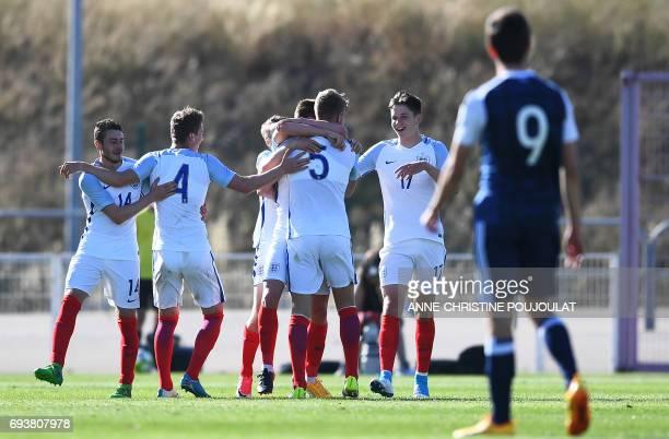 England's players Elliott Embleton Joshua Tymon Joseph Worrall and George Hirst celebrate after England's midfielder Harvey Barnes scored a goal...