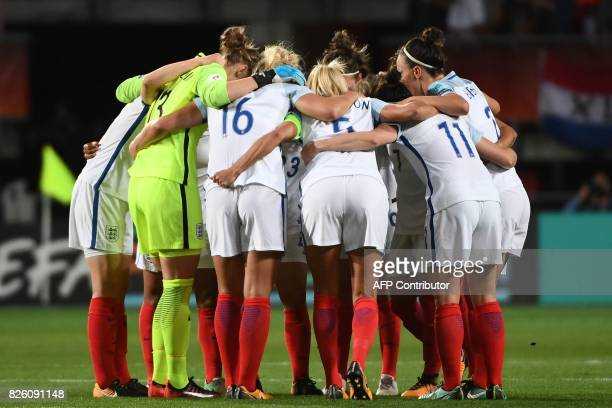 England's players huddle at halftime the UEFA Womens Euro 2017 football tournament semifinal match between Netherlands and England at the FC Twente...