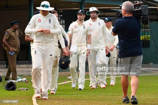 England's players leave the ground led by captain Joe Root during the second day of a four-day practice match between Sri Lanka Board President's XI...
