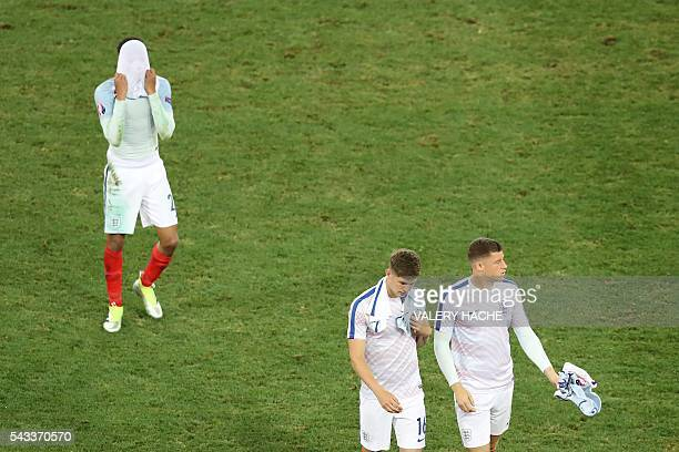 England's players leave the pitch after the Euro 2016 round of 16 football match between England and Iceland at the Allianz Riviera stadium in Nice...