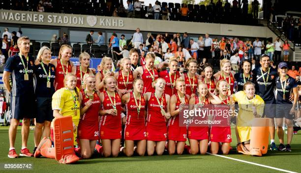 England's players pose as they celebrate after their victory in the bronze medal match against Germany at the Women's Rabo EuroHockey Championships...