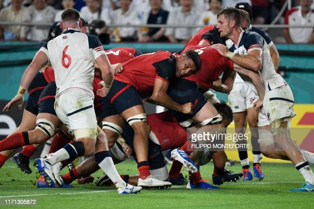 England's players push through and England's number 8 Billy Vunipola scores a try during the Japan 2019 Rugby World Cup Pool C match between England...