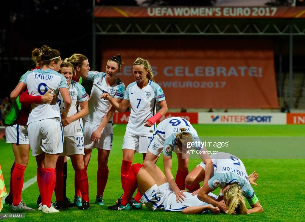 England's players react after scoring a goal during the UEFA Women's Euro 2017 tournament quarter-final football match between England and France at Stadium De Adelaarshorst in Deventer, on July 30, 2017. /