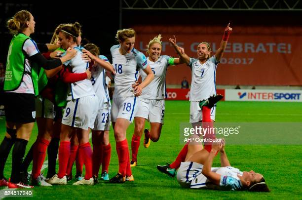 England's players react after scoring a goal during the UEFA Women's Euro 2017 tournament quarterfinal football match between England and France at...