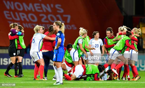 England's players react after the UEFA Women's Euro 2017 tournament quarterfinal football match between England and France at Stadium De...