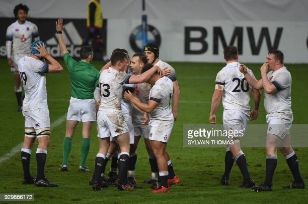 England's players react during the Six Nations U20 rugby union match between France and England on March 9 2018 at the Mediterrannee Stadium in...