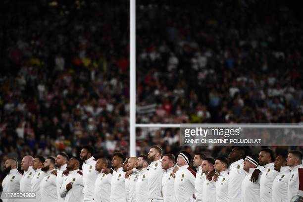 England's players sing the national anthem before the Japan 2019 Rugby World Cup semifinal match between England and New Zealand at the International...