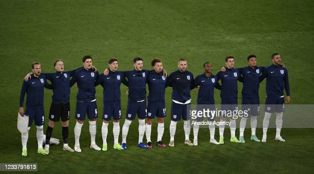England's players sing the national anthem before the start of the UEFA EURO 2020 quarterfinal football match between Ukraine and England at the...