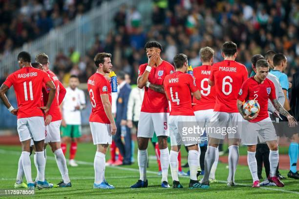 England's players wait on the pitch during a temporary interruption of the Euro 2020 Group A football qualification match between Bulgaria and...