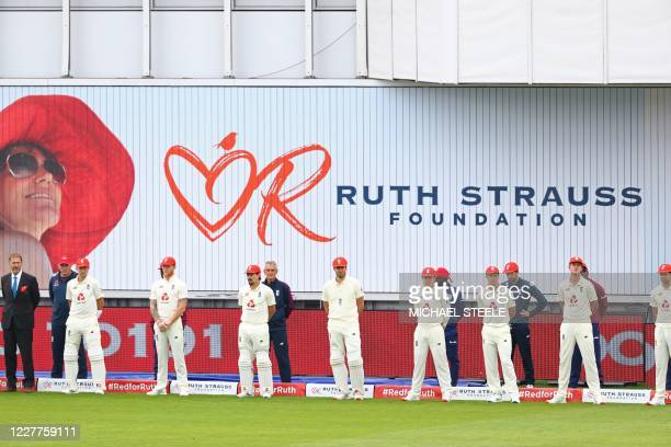 England's players wear red caps for Ruth Strauss Foundation Day, prior to the start of the third Test cricket match between England and the West...