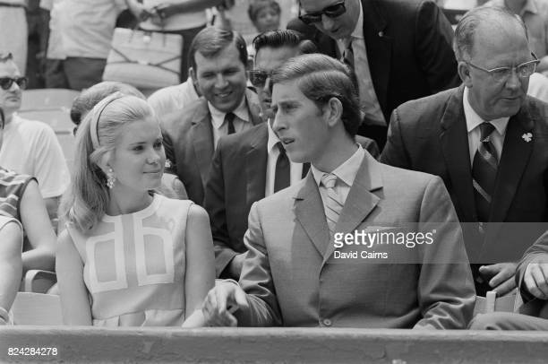 England's Prince Charles sits with Tricia Nixon daughter of American President Richard Nixon during a baseball game at RFK Stadium the home field of...