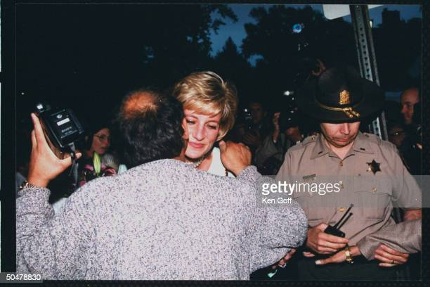 England's Princess Diana hugging Joseph Zaghal during a visit to the US