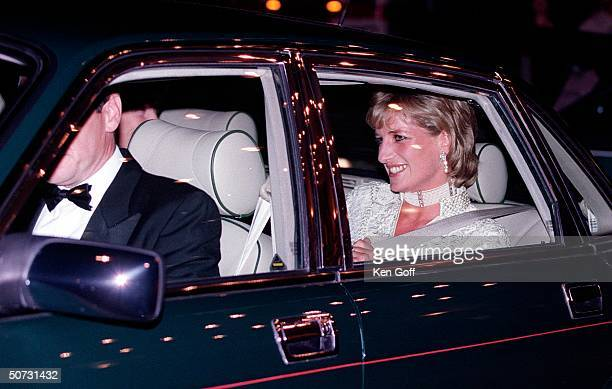 England's Princess Diana in back seat of car leaving the Dorchester Hotel after attending a function