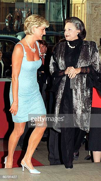 England's Princess Diana in short light blue beaded dress w Lady Pamela Harlech at the Royal Albert Hall for a performance of Swan Lake by the...