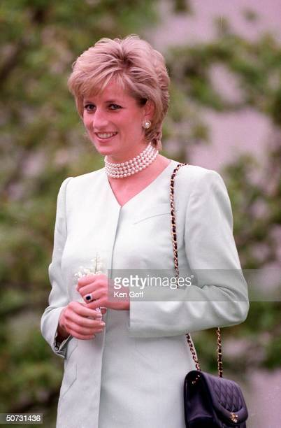 England's Princess Diana in white w pearl choker on the first day of her visit to Chicago arriving at Northwestern University