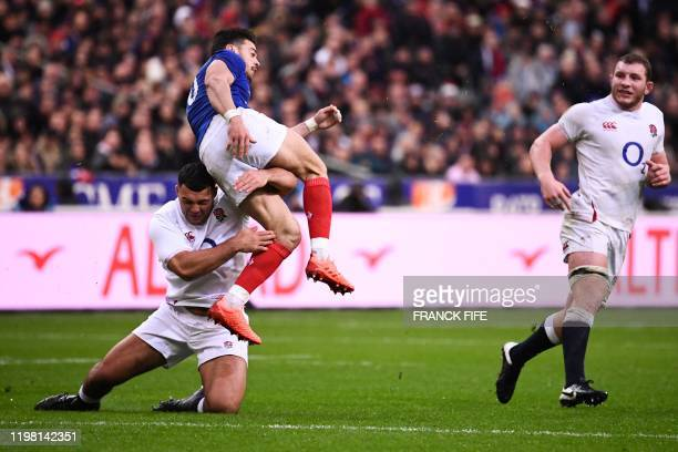 England's prop Ellis Genge tackles France's fly-half Romain Ntamack during the Six Nations rugby union tournament match between France and England at...