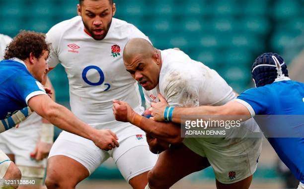England's prop Kyle Sinckler vies with Italy's number 8 Michele Lamaro and Italy's hooker Luca Biga during the Six Nations international rugby union...