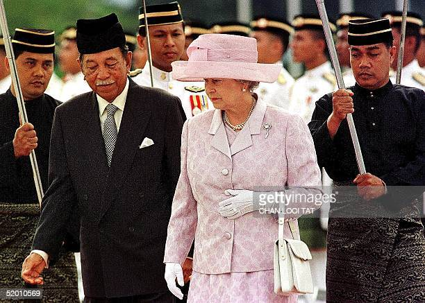 England's Queen Elizabeth II is escorted by Malaysia's King Jaafar during the official welcoming ceremony in Kuala Lumpur 21 September. The Queen who...