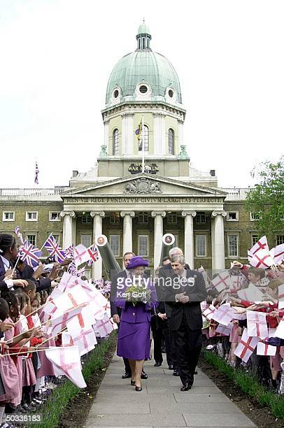 England's Queen Elizabeth II leaving Imperial War Museum through rows of local school children after opening the permanent exhibition to the Holocaust