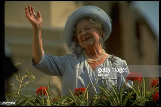 England's Queen Mother, Elizabeth, waving charmingly.