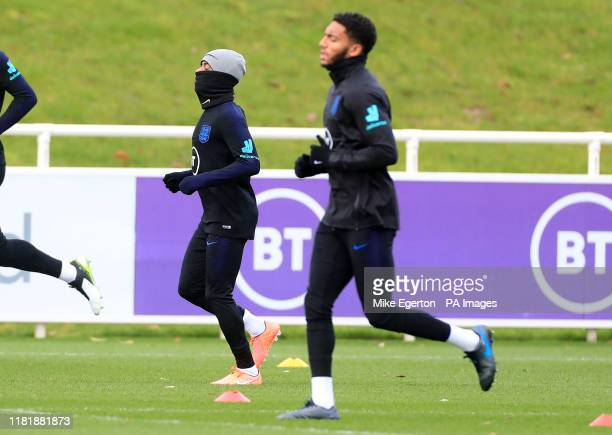 England's Raheem Sterling and Joe Gomez during the training session at St George's Park Burton