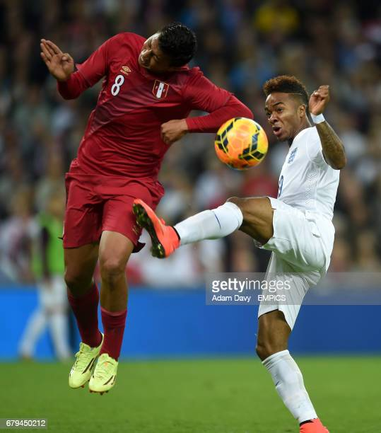 England's Raheem Sterling battles for the ball with Peru's Andre Carillo