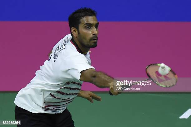 England's Rajiv Ouseph returns to India's Sameer Verma during their round two mens's singles match during the 2017 BWF World Championships of...