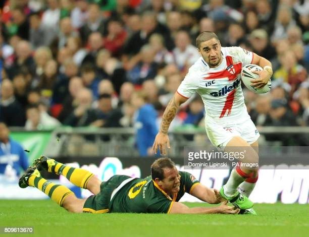 England's Rangi Chase avoids the tackle of Australia's Matthew Scott during the Gillette Four Nations match at Wembley Stadium London