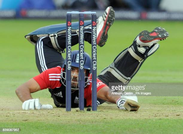 England's Ravi Bopara dives to avoid a run out during the One Day International between England and India at Lord's cricket ground, London