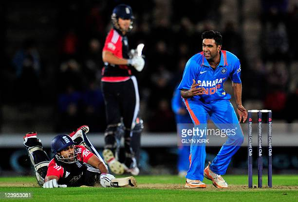 England's Ravi Bopara makes it back to his crease while India's Ravichandran Ashwin looks on during the One Day International cricket match between...