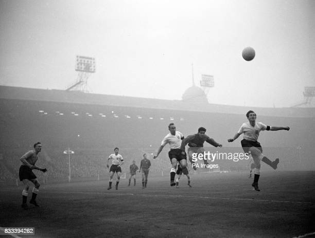 England's Ronald Clayton heads clear against Spain