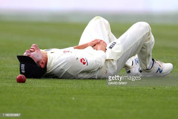 England's Rory Burns reacts as he drops a possible catch on the first day of the second cricket Test between England and New Zealand at Seddon Park...