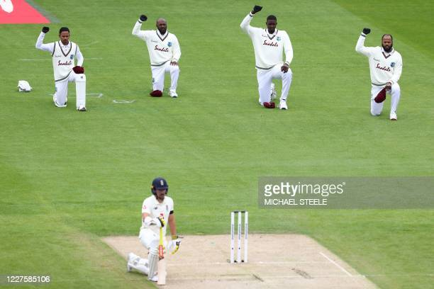 England's Rory Burns takes the knee alongside West Indies players on the first day of the second Test cricket match between England and the West...