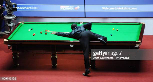 England's Rory McLeod at the table during his second round match of the Betfredcom World Snooker Championships at the Crucible Sheffield