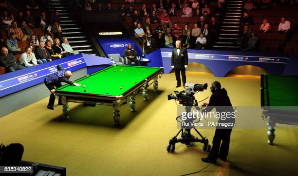 England's Rory McLeod watches England's Mark King in action during the Betfredcom World Snooker Championship at The Crucible Theatre Sheffield