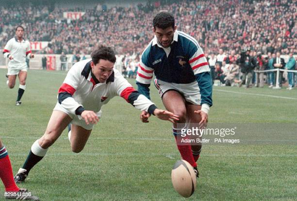 England's Rory Underwood followed by Emiel Ntamack goes to score a try that was not allowed in the first half of the France v England Five Nations...